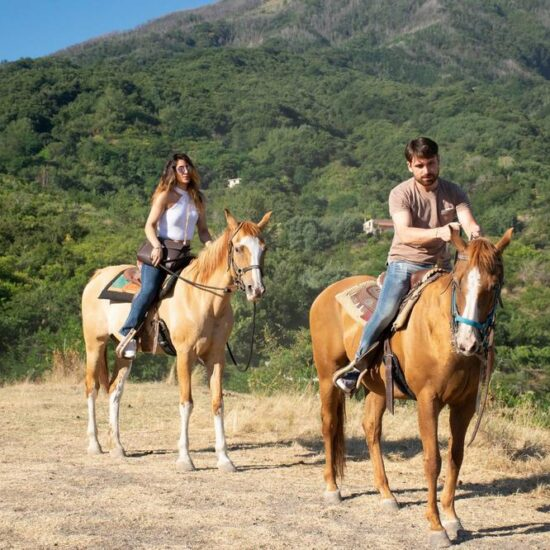 Couple riding horse in the Vesuvius National Park